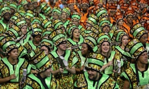 Members of the samba school perform during a parade of the carnival