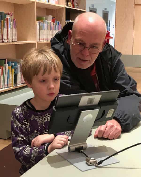 Joris Niekus and his father, Marcel, use an iPad in the Forum in Groningen