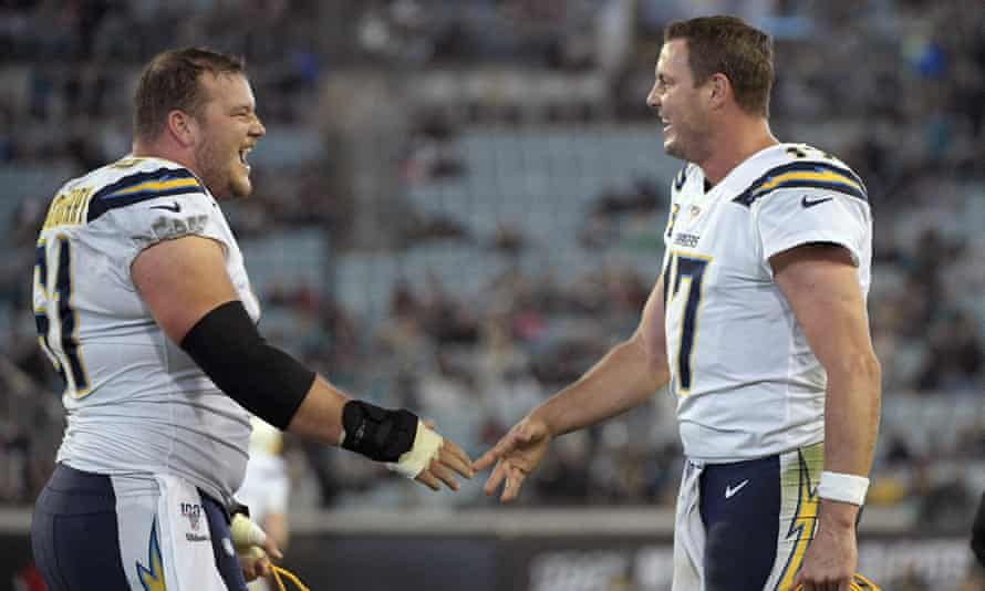 Philip Rivers, right, celebrates with center Scott Quessenberry. But how much longer will Rivers be with the Chargers?