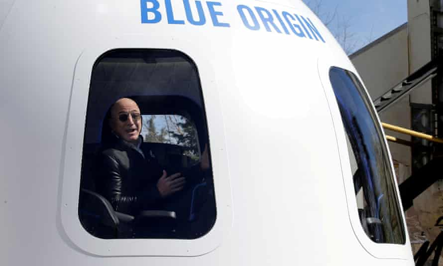 Amazon and Blue Origin founder Jeff Bezos sits in the New Shepard rocket booster and Crew Capsule mockup in Colorado Springs, Colorado.