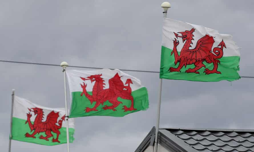 Welsh flags are seen at a holiday park in Towyn.