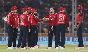 Wood celebrates after taking the wicket of Dhawan.