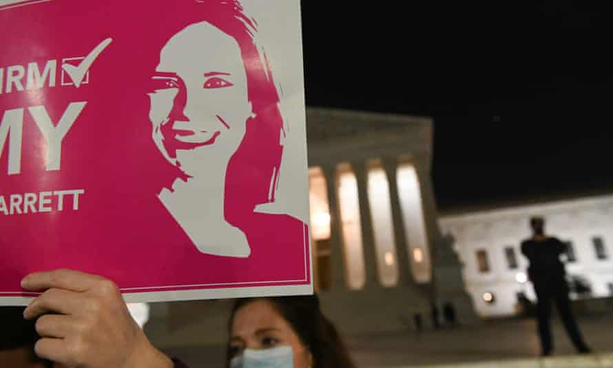 An Amy Coney Barrett supporter holds aloft a poster outside the supreme court in October. The Christian right could be further emboldened after her controversial appointment.
