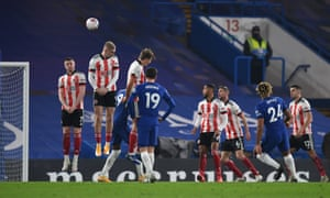 Reece James fires a free kick over the Blades' wall but can't beat their keeper.