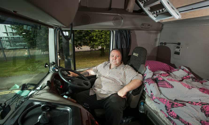 HGV driver Mark Hughes in the cab of his lorry.