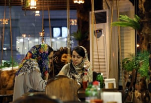 Women at a cafe in Tehran.