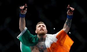Conor McGregor celebrates with the Irish flag.