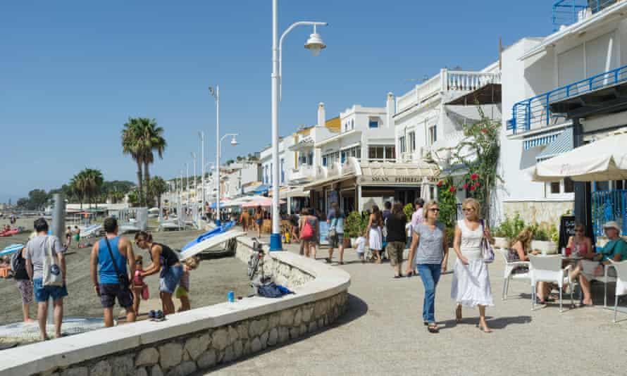 People at the promenade in Pedregalejo, Malaga, Andalusia, Spain.