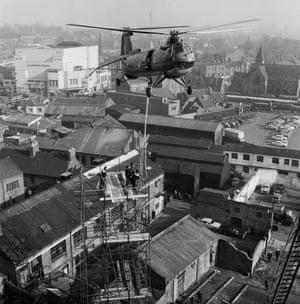 Helicopter hoisting bronze spire
