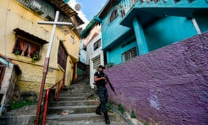 A member of Faes on patrol during an operation against criminal groups in Caracas last month.
