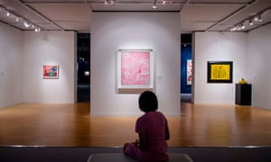 A woman looks at Japanese artist Kusama Yayois Untitled - Infinity Net (C) during the Sothebys Autumn Sales week in Hong Kong