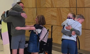 A family from New Zealnd reunite at Sydney International Airport, Sydney, Monday, April 19, 2021. From Sunday night, travellers from Australia were once again able to cross the Tasman quarantine-free after more than a year of tight restrictions.