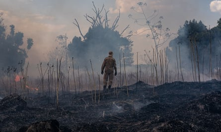 A firefighter combats a fire in the the Sorriso municipality, Mato Grosso state, Brazil, on 26 August.