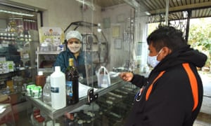 A man buys chlorine dioxide in a pharmacy in Cochabamba, Bolivia.