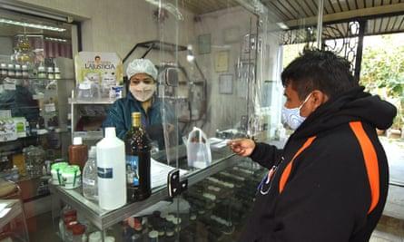 A man buys chlorine dioxide in a pharmacy in Cochabamba, Bolivia.