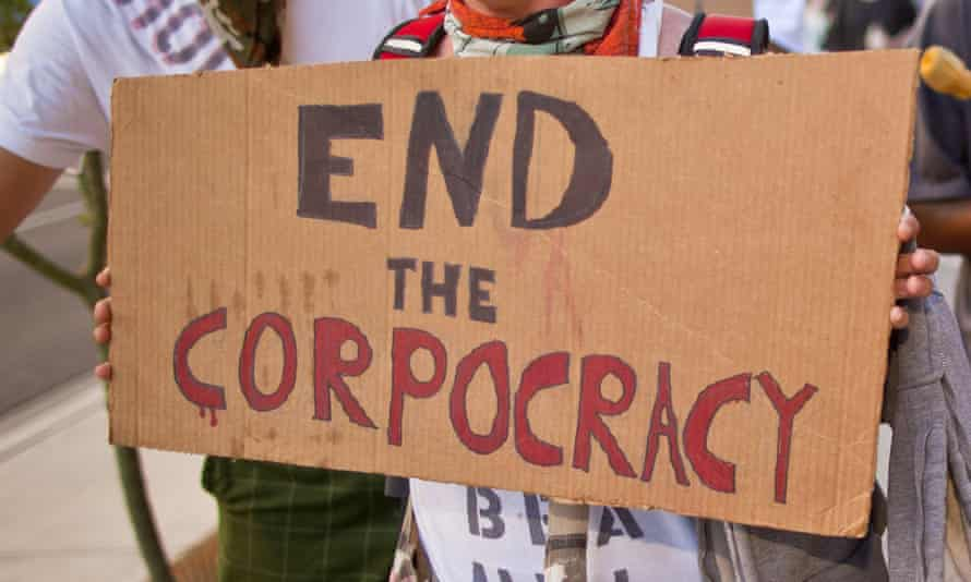 sign saying 'end the corpocracy'
