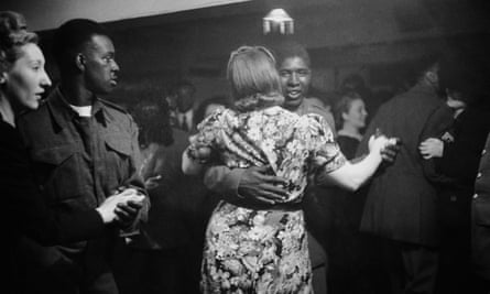 An African American GI dances with a white woman
