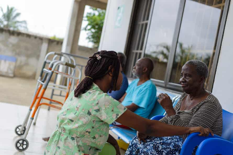 Lois Anim Yirenkyi, a health worker at Comfort For The Aged, talks to one of the home's residents.