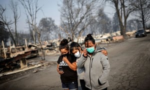 Sandra, Daniela, and Ester Reyes react while visiting their destroyed trailer home after the wildfires destroyed a neighbourhood in Bear Creek, Phoenix, Oregon.