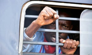 Ugandan presidential candidate Bobi Wine, whose real name is Robert Kyagulanyi, inside a police van after his arrest.