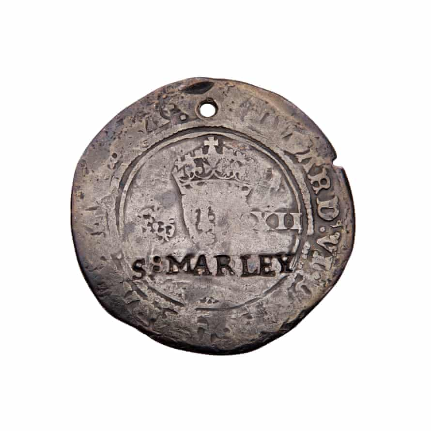 An Edward VI shilling token left by a mother with her baby at the Foundling hospital.