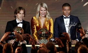 Luka Modric, Ada Hegerberg and Kylian Mbappé pose with their awards.