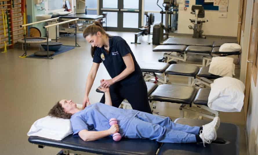 Physiotherapist Lauren Castledine-Wolfe treats a staff member at Kingston hospital in south London.