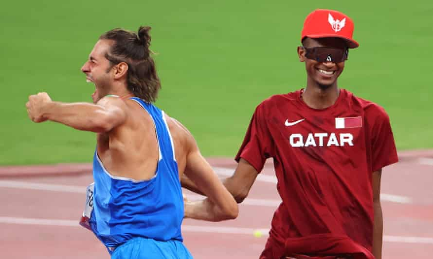Italy's Gianmarco Tamberi and Mutaz Essa Barshim of Qatar celebrate after agreeing to share gold in the men's high jump final.