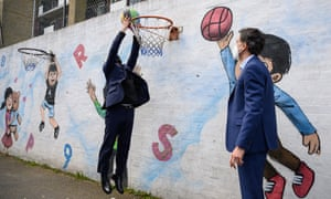 Mayor of London Sadiq Khan (L) and Shadow Secretary of State for Business Ed Miliband playing basketball during a campaign visit to Fairfield Play Centre in London, which is reopen for business.
