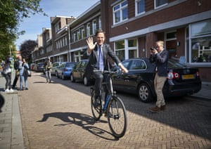 Hague, Netherlands. Dutch prime minister, Mark Rutte, leaves on his bicycle after voting in the European elections