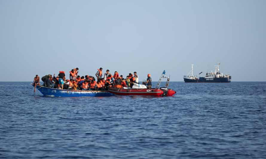 A boat carrying migrants being rescued in July 2019 between Italy and Malta