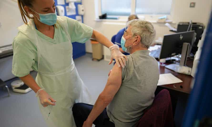 Patients receiving the Pfizer/BioNTech vaccine at a GP surgery in York, December 2020