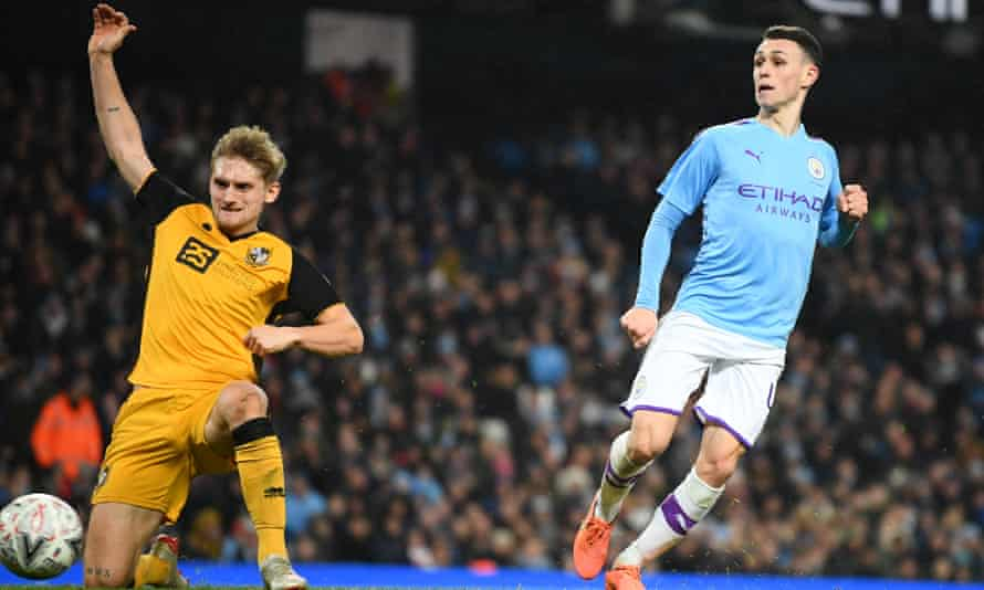 Phil Foden slots in Manchester City's fourth goal against Port Vale.