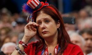 A delegate wipes away tears.