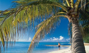 The beach at Rum Point, Grand Cayman Islands, which along with the British Virgin Islands are under pressure to from the UK to adopt public registers of company ownership.