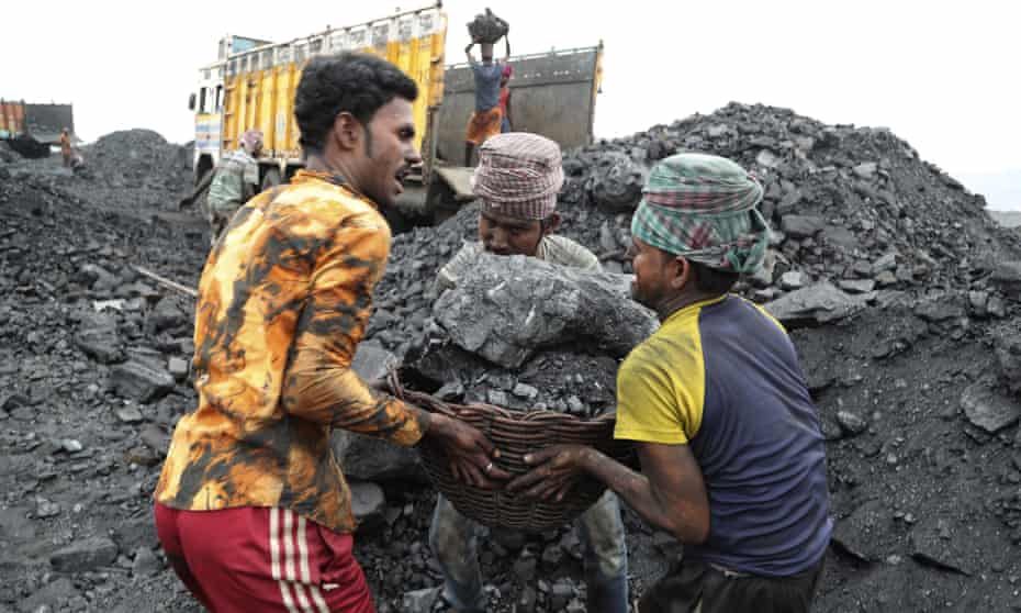 Workers transporting coal in Jharkhand, eastern India, 2019