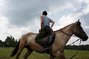 """Students train horse-back riding at the Historical War Camp, in Borodino, Russia. The project statement of the camp says: """"To awaken in the younger generation a keen interest in the history of the Fatherland, the glorious deeds of our ancestors, to facilitate the expansion of military-historical knowledge."""""""