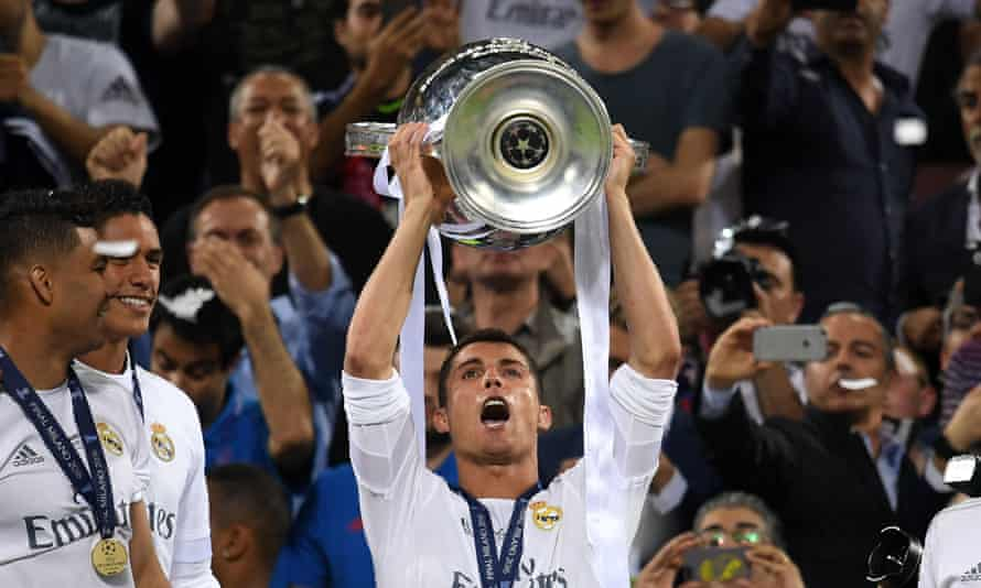 Cristiano Ronaldo of Real Madrid holds aloft the Champions League trophy