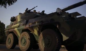 A convoy of Senegalese soldiers approach the Gambia border.
