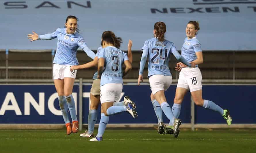 Manchester City's Caroline Weir (left) celebrates scoring