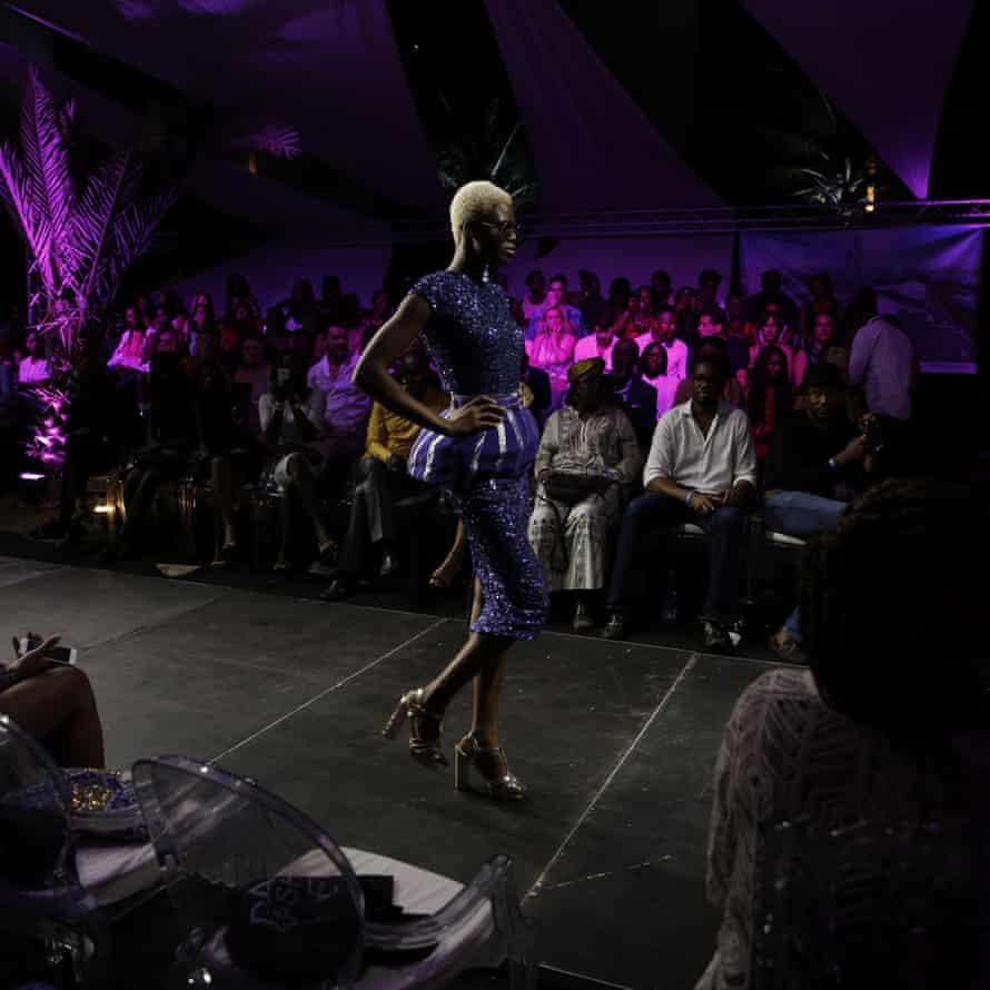 A model walks the runway during Dakar fashion week, June 2017