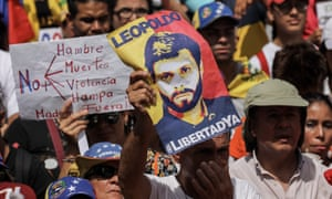 Opposition supporters, some holding posters of opposition leader Leopoldo López, rally to mark the 100th day of protests in Caracas.