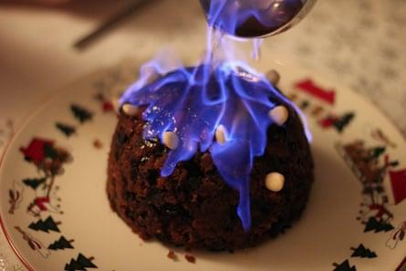 A Christmas pudding on fire