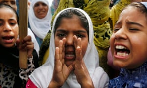 Women shout slogans during a protest in Anchar.