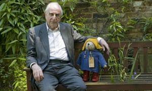 Michael Bond sitting with a Paddington Bear in 2008.
