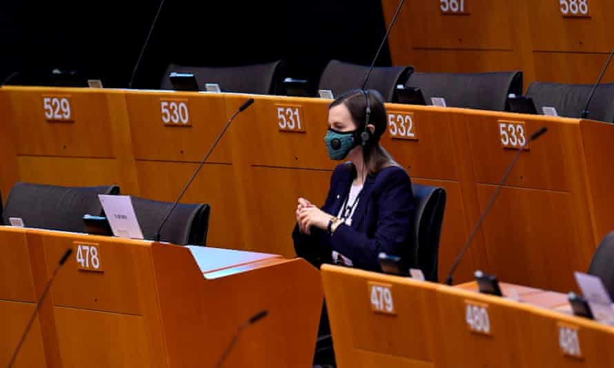 A MEPt wears mask in an almost empty European parliament in Brussels last week.
