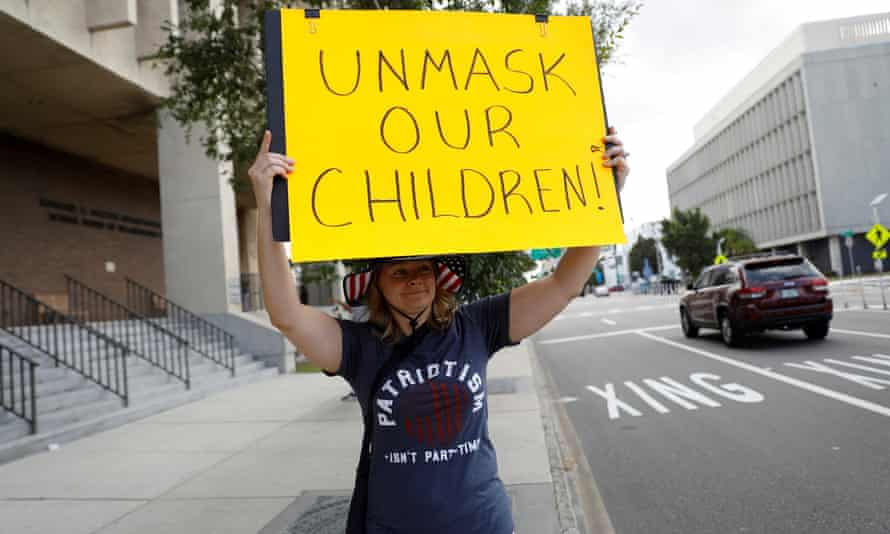A person protests against school mask mandates in Tampa in May.