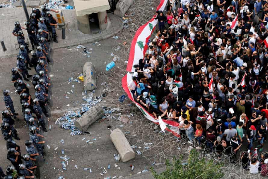 Demonstrators face off against riot police in Beirut, in October 2019.