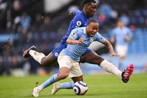 Manchester City's Raheem Sterling goes down under the tackle from Chelsea's Kurt Zouma.
