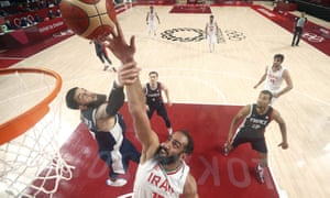 Iran's Hamed Haddadi is fouled by France's Vincent Poirier